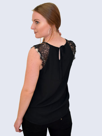 Back view of this simple sleeveless lace blouse with chiffon detailing is perfect for your office wear wardrobe capsule. Black with a V neck and lace chiffon shoulder style. In this picture from the back to show the detail of the blouse.