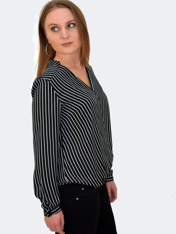 Side view to our cross over Black Blouse with White stripes. Can be paired with a nice pair of Jeans, formal trousers or a skirt. Should form part of your office work capsule.