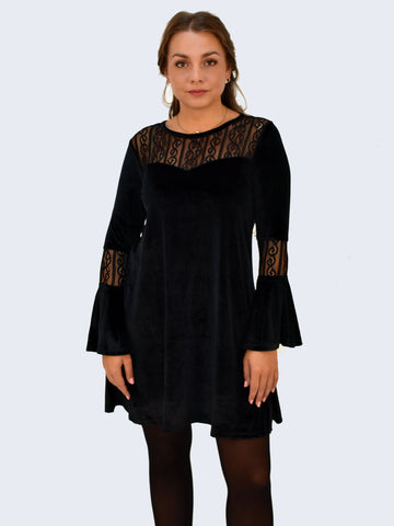 Front picture of our Black Velvet dress. This dress has bell sleeves and lace detailing at the top and on the sleeves.