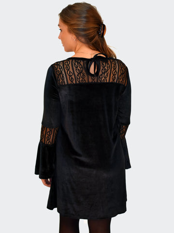 Back picture of a velvet black mini dress with lace detailing.