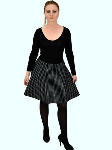 A full length picture of our black and white check midi skirt as worn by our model.