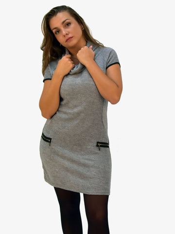 Picture of our Cap sleeve knitted dress with fake zip pockets. Sits above the knee.