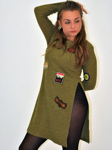 A long sleeve Knitted Khaki badge dress with side split on the right.