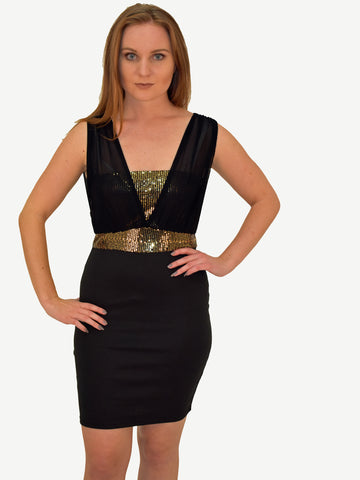 Front on picture of our model wearing our black bandeau bodycon dress with gold sequins