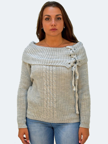 Picture of our model wearing our grey chunky jumper with detailing on the right shoulder