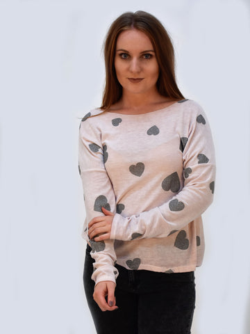 a picture of our long sleeve top in pink with silver hearts on.