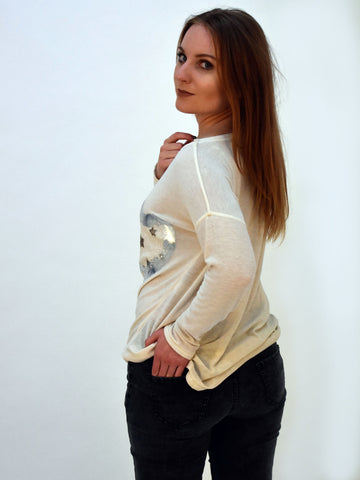 Our model looking over her shoulder wearing our cream heart jumper