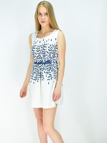 Slight side on view of our White jacquard dress with a blue leaf print