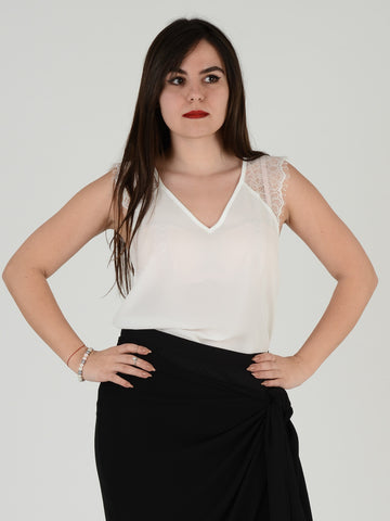 Our ivory sleevless Vneck blouse with lace upper part to both shoulders.