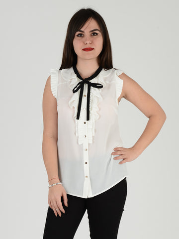 A front on picture of our Sleevless frill blouse in Cream with a black tie facilty