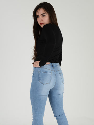 A close up shot of our light blue denim high waisted skinny jeans, from the back.