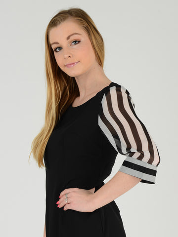 Side picture of a Black dress with stripe sleeve
