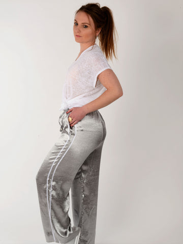 A side on view of our satin side stripe trousers as worn by our model