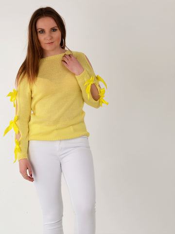 A front on picture of this beautiful bow sleeve jumper in Lemon as worn by our model.