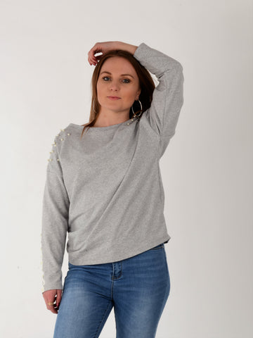 A front on picture of our model wearing our grey sweatshirt with pearl detailing on the sleeve