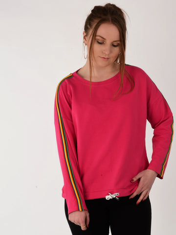 A picture of our model wearing our hot pink stripe sleeve sweatshirt
