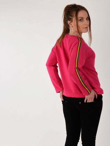 A back view of our model wearing a hot pink sweatshirt