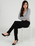 Full length photo of our Black skinny Jeans with our model sitting on a stool. Our Model is 5ft 3 inches tall and wears a Uk size 8
