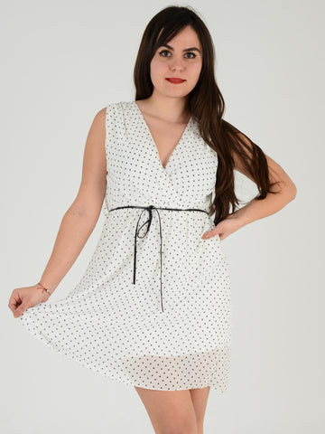 Front picture of our white sleevless spotty sundress. Our Model is 5ft 3 inches and wears an UK size 8