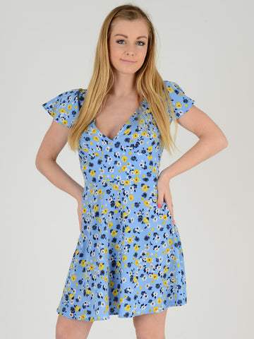 Photo of our Blue Floral tea dress. Our model is 5ft 5 inches tall and wears an UK size 8