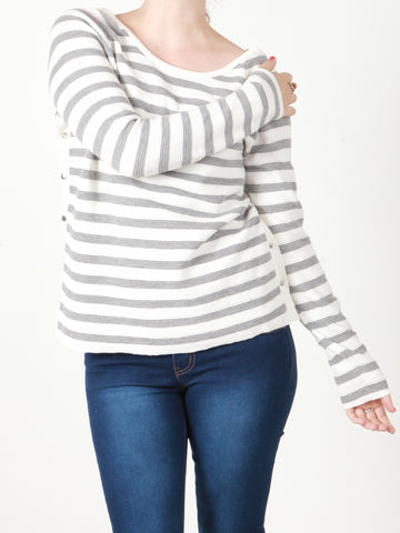 She is wearing our white and grey ribbed jumper with a back Vneck line