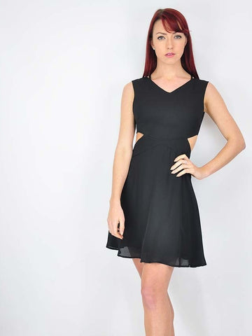 Our new little black dress with cut out side panels to give a fresh look to the little black dress
