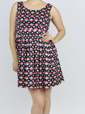A picture of a floral skater dress. Our model is 5ft 4 inches and wears an Uk size 10.