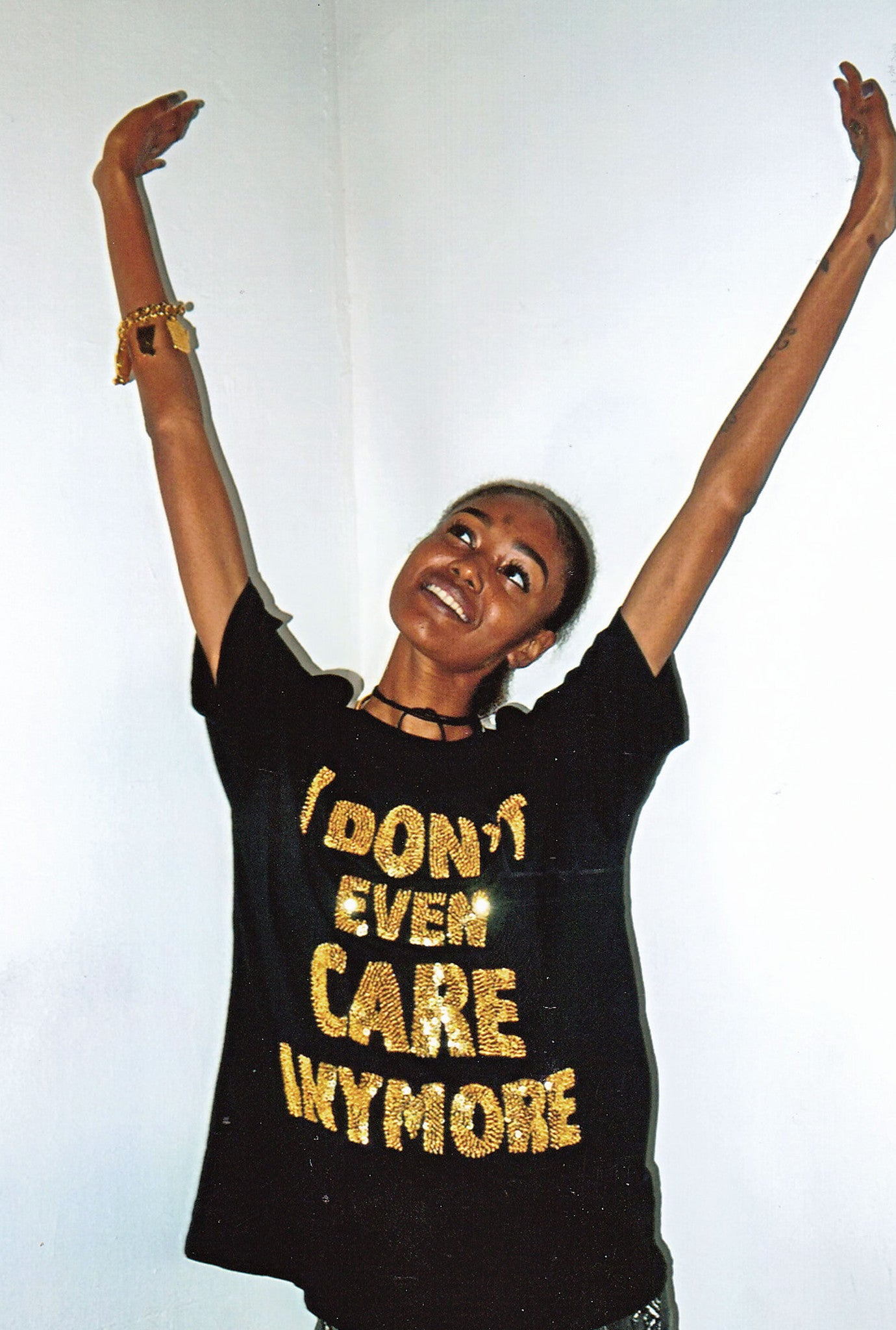IDGAF cotton tee, I don't even care anymore cotton tee, cotton tee, sequinned tee, sequinned text, sequinned words, sequinned, sequins, cotton tee, cotton t-shirt, tee, t-shirt, gold, gold sequins, black, sequinned tee, discount universe, di$count universe