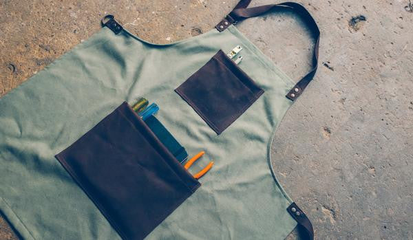THE JERSEY APRON - OLIVE GREEN WITH SADDLE BROWN LEATHER
