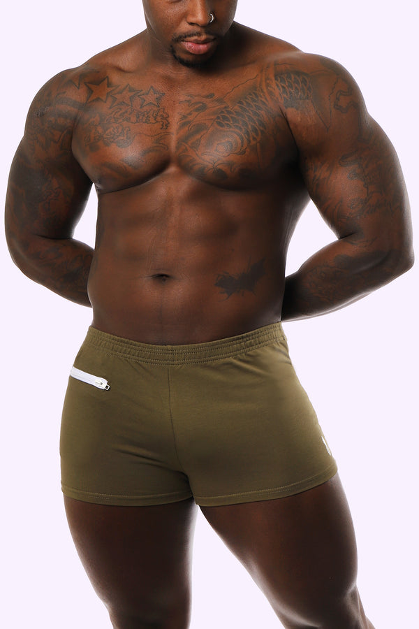 olive green short shorts. short shorts for men. gay men fashion brand. gay brand. short shorts with pocket.