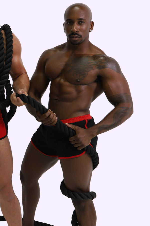 max konnor. gay pornstar. black shorts. black short shorts. black and red shorts. black and red short shorts.