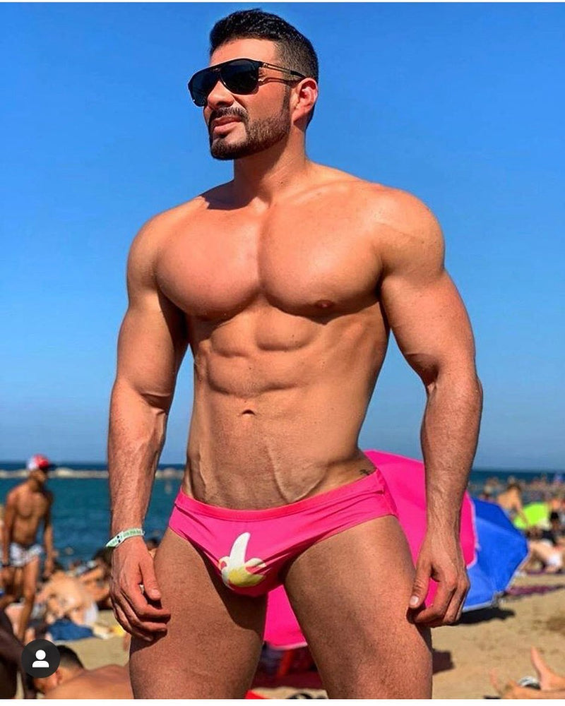 gay man wearing pink speedo with banana emoji printed on the crotch