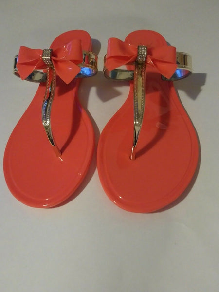 Womens Orange Jelly Flat Sandals with a Rhinestone Bowtie