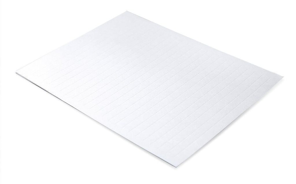 angled image of a single sheet of ghost paper with debossed lines