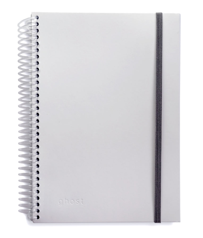 Image of the front of a spiral ghost paper notebook white cover with gray elastic closure