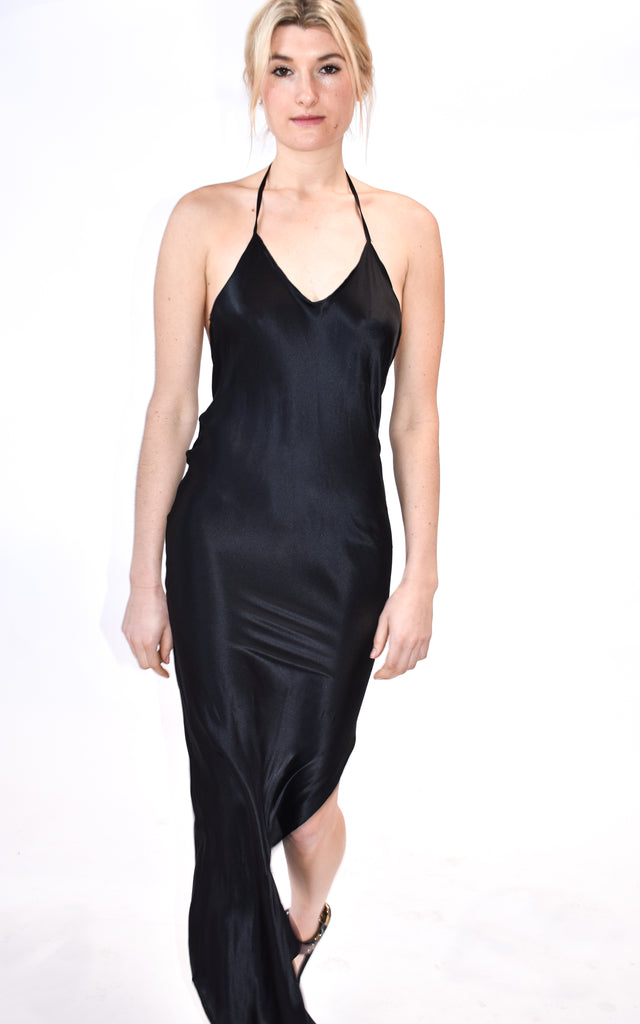 Bias cut, low back, adjustable strap slip dress in black silk. Beautiful for an evening event, wedding, or chic daytime look. Cut to fit slightly snuggly through hips to show off your curves. If you prefer a looser fit, we suggest that you size up! This item is also available as a custom order!