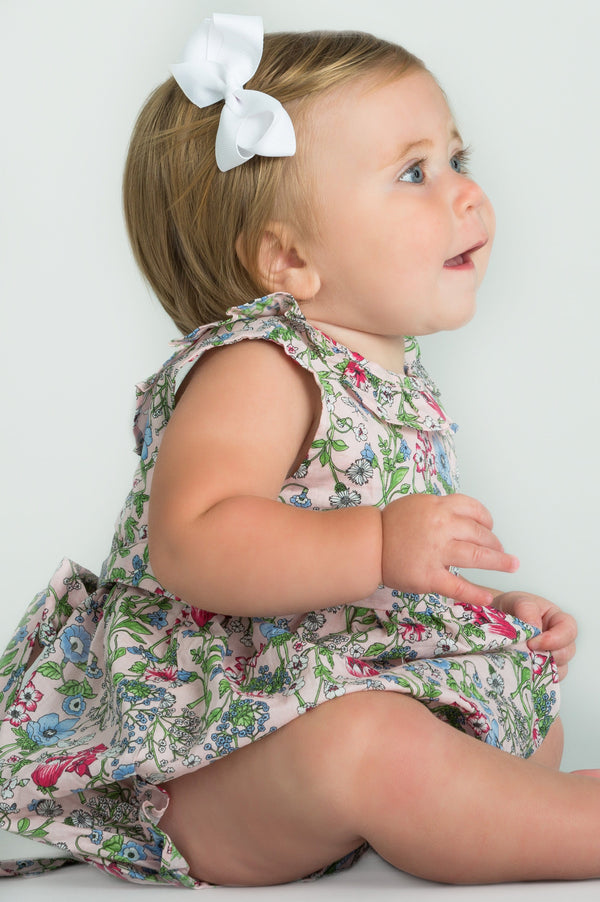 Little English baby girl's floral bubble