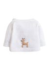 back view of infant white cotton knit cardigan sweater with reindeer crochet details