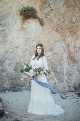blue silk ribbon in sand and sea shoot