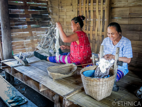 Karen hill tribe people are making cotton yarn for weaving their cloths