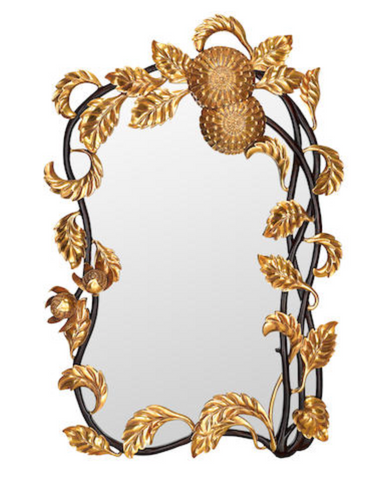 A WHIMSICAL FRENCH CARVED GILTWOOD AND MAHOGANY MIRROR US$ 2,500 - 3,500