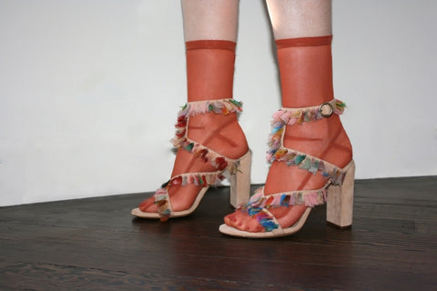 Darner Orange mesh socks featured with Fendi heels