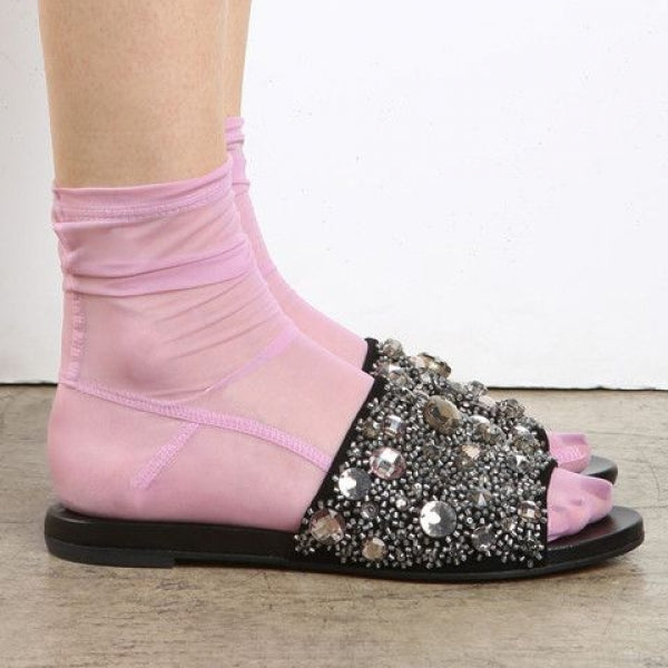 Darner mesh pink socks paired up with Rochas sandals.