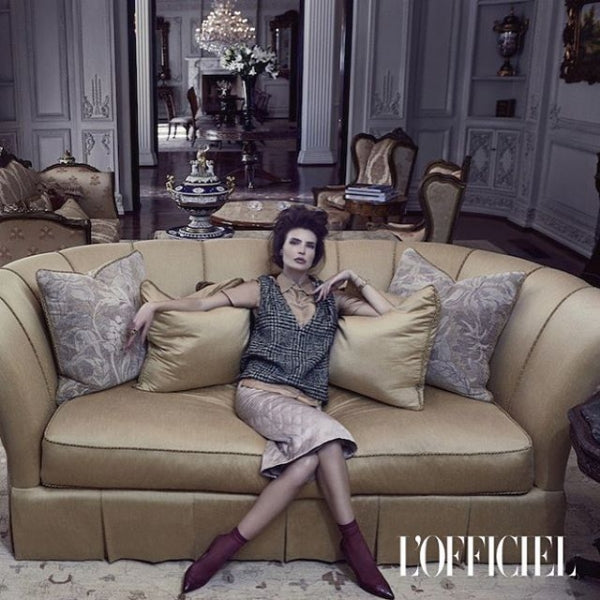 L'OFFICIEL Magazine features Darner red mesh socks in cover story spread.