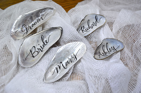 Calligraphy Mussel Shell & Mini Bottle Name Place Cards Featured on Emmaline Bride!