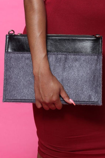 In A Furry Grey Faux Clutch Bag