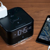 Bluetooth Wireless Qi Charging Power Cube and Alarm Clock for vacation rentals | GuestOutfitters.com