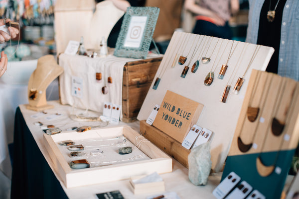 Wild Blue Yonder craft show table set up  - handmade jewelry made from wood sitting on a table