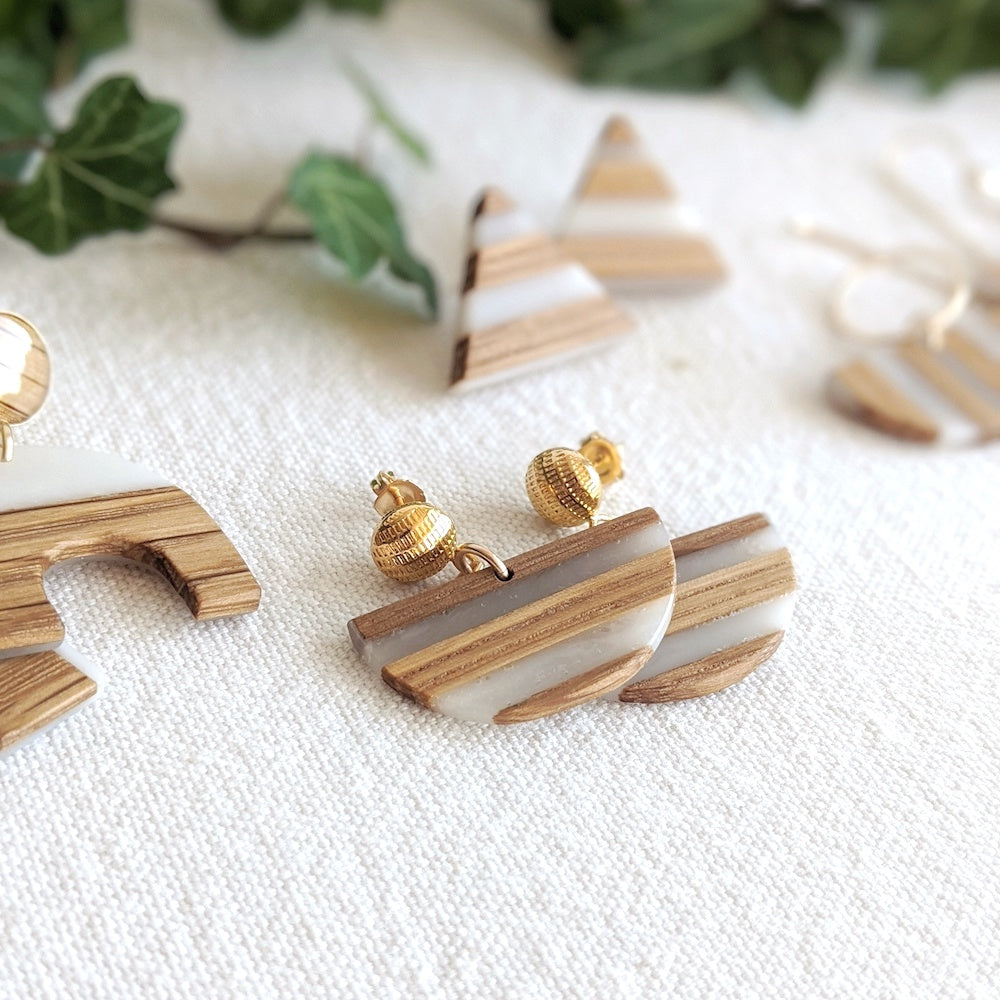 Handmade wood earrings. Wood and white epoxy resin in half moon shapes. Natural and durable. 14k gold filled and sterling silver earring studs and posts and hammered loops. Wild Blue Yonder.