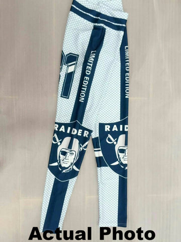 Actual side-view photo of the Raiders leggings in Blue-green and Silver color.